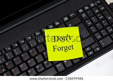 Don't Forget, Post-it Note on Laptop - stock photo