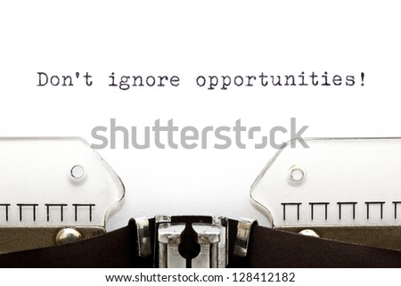 Don't Ignore Opportunities printed on an old typewriter. - stock photo