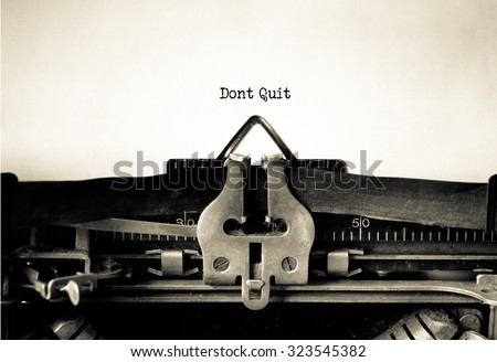 Don't Quit determination message typed on a Vintage Typewriter.