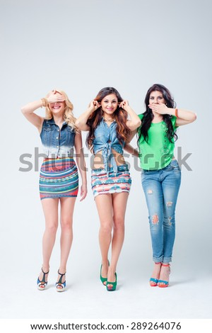 Don't see, don't talk, don't hear. Full length studio portrait of three beautiful young women gesturing. - stock photo