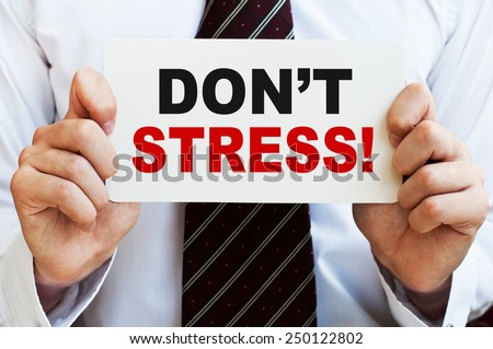 Don't Stress! message in businessman's hands - stock photo