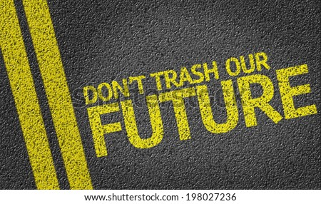 Don't Trash Our Future written on the road - stock photo