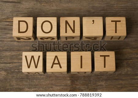 DON'T WAIT text on wooden cubes