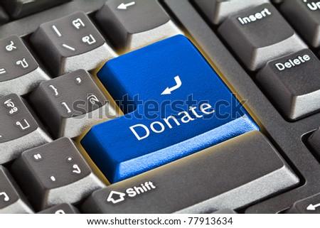 Donate key - stock photo