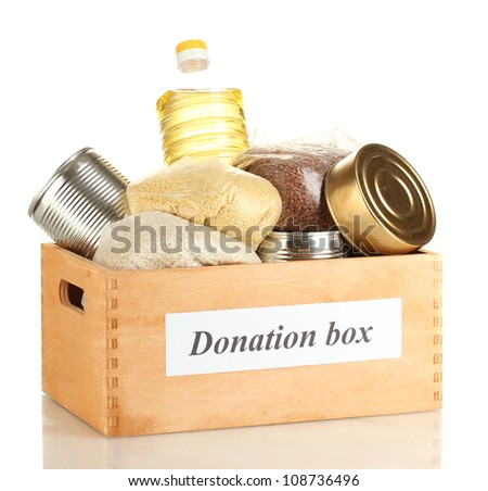 Donation box with food isolated on white - stock photo
