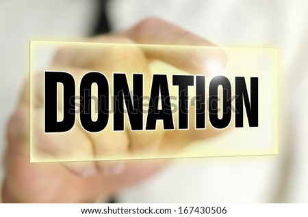 Donation  button on virtual screen. - stock photo