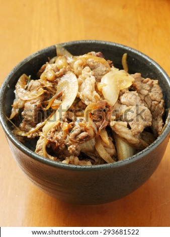 donburi, pork rice bowl, bowl of rice with food on top