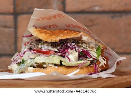 Doner kebab in pita in paper bag - stock photo