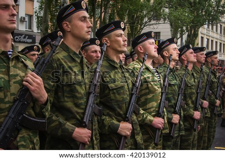 DONETSK, Donetsk People Republic. May 8: Soldiers of the DPR on the main street of the Donetsk city during rehearsal for Victoty Parade. 2016, May 8.
