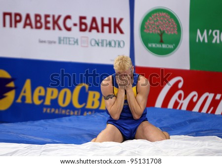 DONETSK, UKRAINE - FEB.11: Denys Yurchenko on the Samsung Pole Vault Stars meeting on February 11, 2012 in Donetsk, Ukraine. He won bronze medal in the pole vault event at Summer Olympics in Beijing. - stock photo