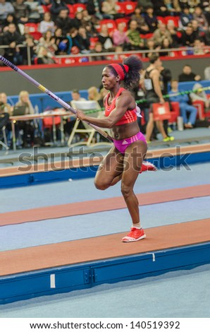 DONETSK,UKRAINE-FEB .09: Yarisley Silva - The silver prize-winner of Olympic Games 2012 takes running start with a pole on Samsung Pole Vault Stars meeting on February 09, 2013 in Donetsk, Ukraine.
