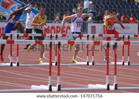 DONETSK, UKRAINE - JULY 11: Boys compete in 110 m hurdles during 8th World Youth Championships in Donetsk, Ukraine on July 11, 2013