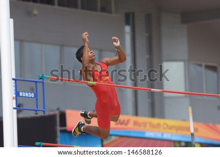 DONETSK, UKRAINE - JULY 12: Jose Rodolfo Pacho of Ecuador competes in Pole Vault during 8th IAAF World Youth Championships in Donetsk, Ukraine on July 12, 2013 - stock photo