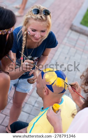 DONETSK, UKRAINE -JUNE 19, 2012: Ukrainian football fan near Donbass Arena stadium before EURO 2012  match England vs Ukraine - stock photo