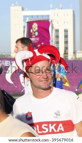 DONETSK, UKRAINE - JUNE 19, 2012: Unidentified Polish soccer fan before UEFA EURO 2012 match in Donetsk on Donbass Arena - stock photo