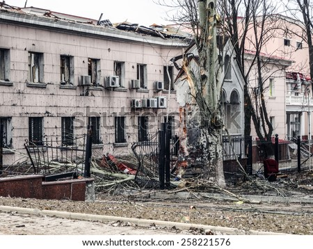 DONETSK, UKRAINE - March 4, 2015: Destroyed houses, Kiev Avenue. This area is adjacent to the Donetsk airport named after Sergei Prokofiev.  - stock photo