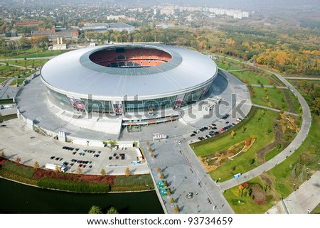 "DONETSK, UKRAINE - OCTOBER 11 - ""DONBAS ARENA"" soccer stadium in Donetsk by aerial view. The stadium will host matches of UEFA Euro 2012. Donetsk, October 11, 2011. - stock photo"
