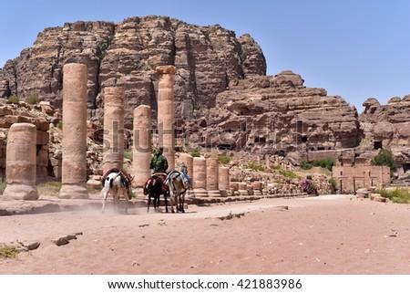 Donkey Ride to the Monastery in Petra, Jordan - stock photo