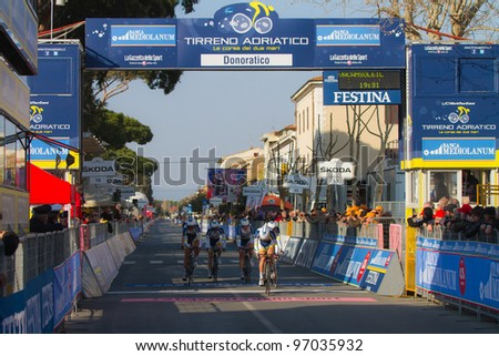 DONORATICO, LIVORNO, ITALY - MARCH 07: Team Vacansoleil during the 1st Team Time Trial stage of 2012 Tirreno-Adriatico on March 07, 2012 in Donoratico, Livorno, Italy - stock photo