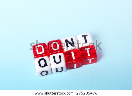 Dont Quit  Do It written on red and white dices on blue background