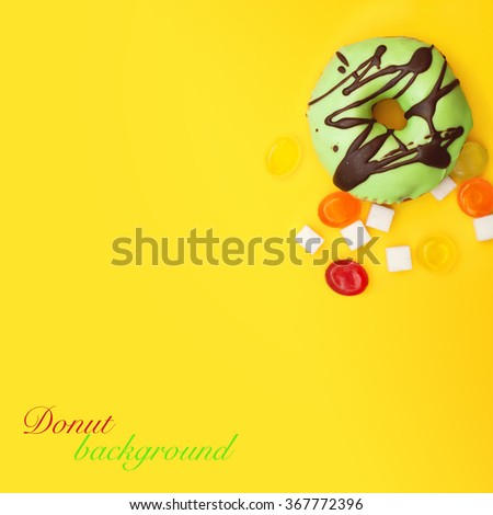 donut and colorful candies background - stock photo