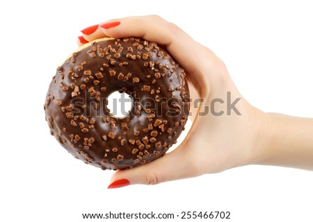 Donut in woman's hands on white background - stock photo