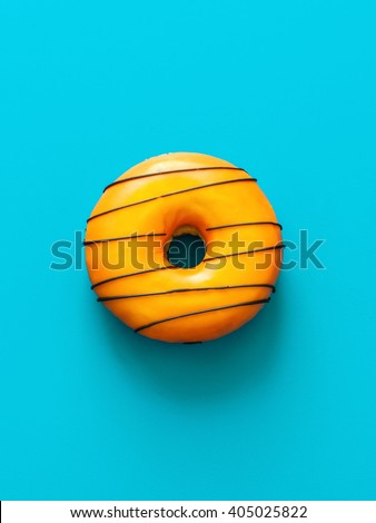 Donut on blue background - stock photo