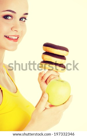Donut or green apple - hard choice. Diet concept. - stock photo