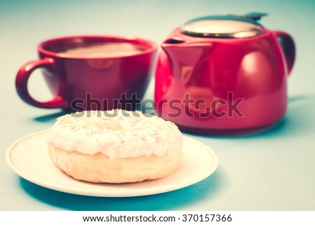 Donut. Sweet food and cup of coffee, tea drink and teapot. Breakfast, dessert with cake, snack. Brown wooden table. Bakery, sugar doughnut. Tasty espresso black hot morning beverage.  - stock photo