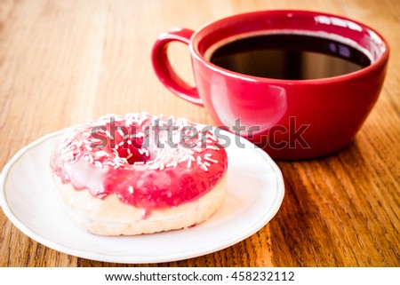 Donut. Sweet food and cup of coffee, tea drink. Breakfast, dessert with cake, snack. Brown wooden table. Bakery, sugar doughnut. Tasty espresso black hot morning beverage.  - stock photo