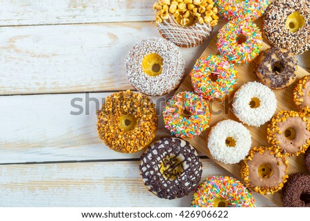 Donut. Sweet icing sugar food. Dessert colorful snack. - stock photo