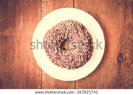 Donut. Sweet icing sugar food. Dessert colorful snack. Glazed chocolate sprinkles. Treat from delicious pastry breakfast. Bakery cake. Doughnut with frosting. Baked unhealthy round.  - stock photo