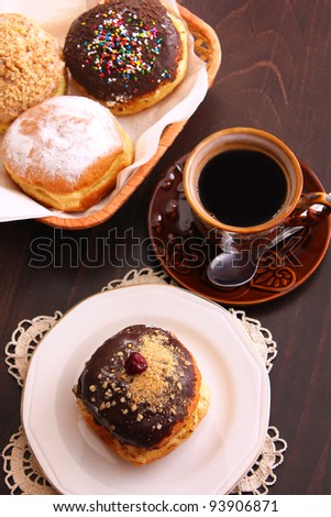 Donuts and a cup of coffee in old-styled fashion