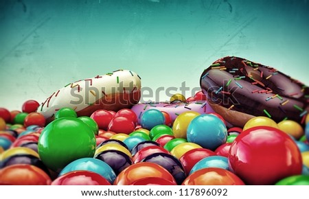 donuts and gumballs isolated on blue background - stock photo