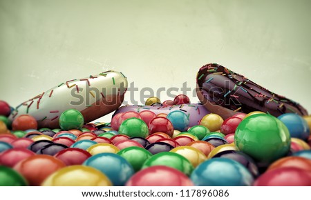 donuts and gumballs isolated on white background - stock photo
