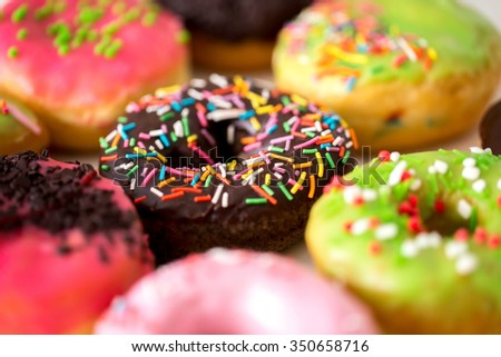 Donuts glazed with sprinkles - stock photo