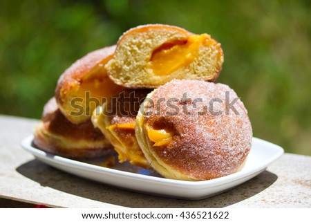 donuts with cream on white dish - stock photo
