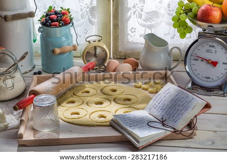 Donuts with fresh ingredients in the rural kitchen - stock photo