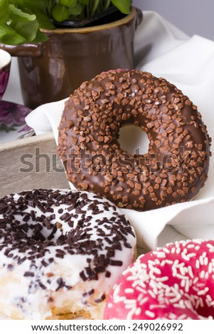 donuts with icing on a white napkin - stock photo