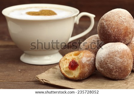 Donuts with powdered sugar - stock photo