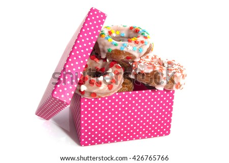 Donuts with sweets in a spotted gift box isolated over white - stock photo
