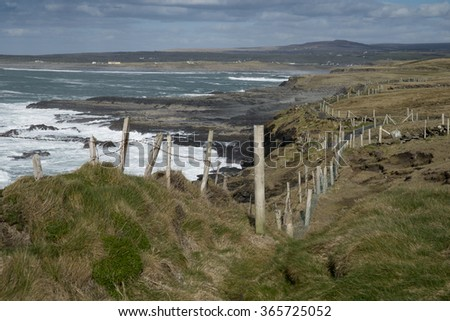 DOOLIN, IRELAND - MARCH 10, 2015: Scenic path at the edge of cliff leading from Doolin towards Cliffs of Moher
