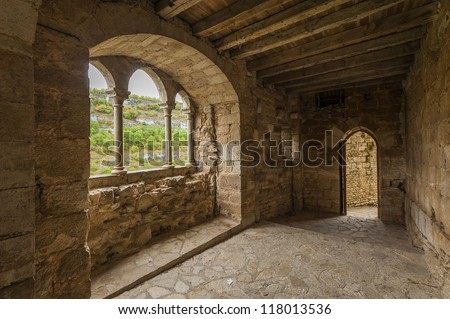 Door and archway in medieval castle - stock photo