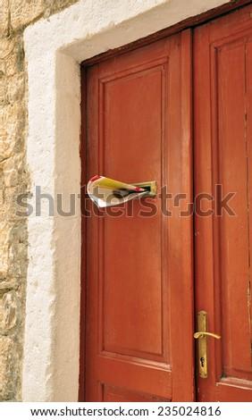 door and newspaper - stock photo