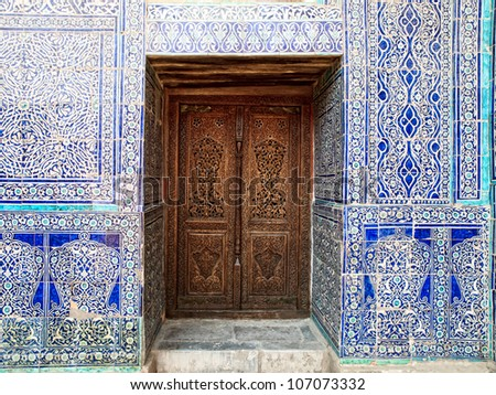 Door and wall with traditional floral decoration in Khiva. Uzbekistan - stock photo