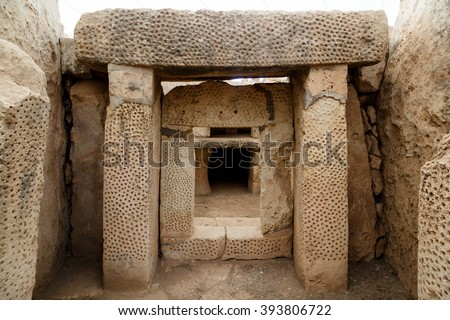 Door and window view of ancient limestone structures of Hagar Qim and Gnajdra Temples in Qrendi, Malta. - stock photo