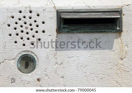 door bell intercom and mail slot on marble wall, Italy - stock photo