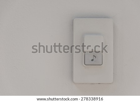 door bell on white wall