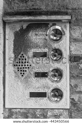 door bells in Venice, Italy . Black and white photography. - stock photo