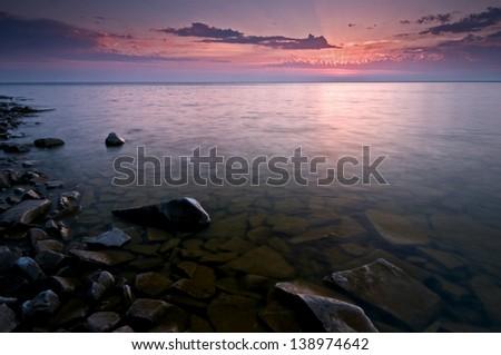 Door Bluff Sunset Sunset colors over Green Bay along the shore of Door Bluff Headlands County Park, Door County, Wisconsin. - stock photo